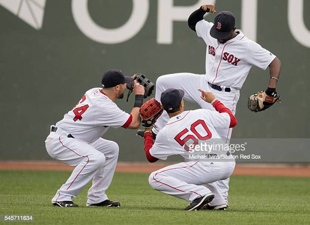 Outfielders Bryce Brentz Mookie Betts and Jackie Bradley Jr #25 celebrate a 41 win over the Tampa Bay Rays on July 9 2016 at Fenway Park in Boston...
