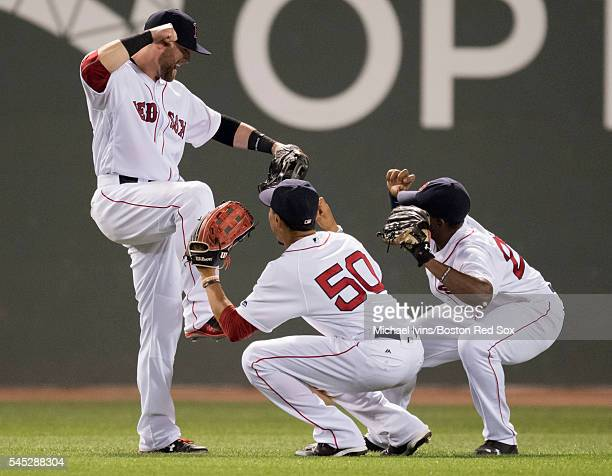 Outfielders Bryce Brentz Mookie Betts and Jackie Bradley Jr #25 of the Boston Red Sox celebrate an 116 victory over the Texas Rangers on July 6 2016...