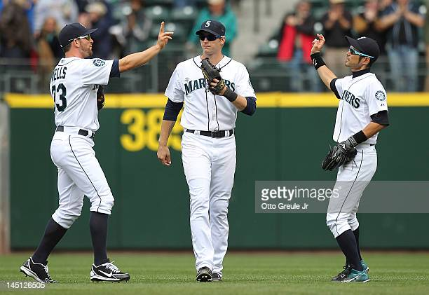 Outfielders Casper Wells Michael Saunders and Ichiro Suzuki of the Seattle Mariners celebrate after defeating the Texas Rangers 53 at Safeco Field on...