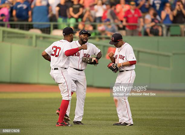 Outfielders Chris Young Jackie Bradley Jr #25 and Mookie Betts of the Boston Red Sox celebrate after a 64 victory over the Toronto Blue Jays on June...