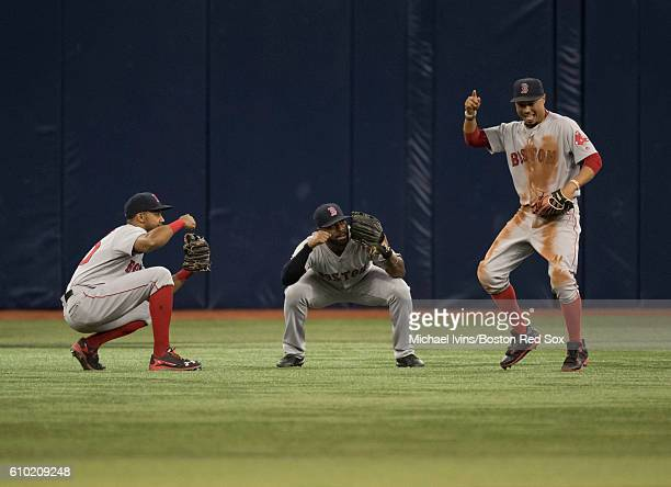 Outfielders Chris Young Jackie Bradley Jr #25 and Mookie Betts of the Boston Red Sox celebrate a 64 win over the Tampa Bay Rays on September 24 2016...