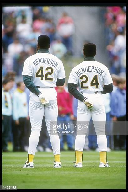 Outfielders Dave Henderson and Rickey Henderson of the Oakland Athletics stand with backs to camera Mandatory Credit Otto Greule /Allsport