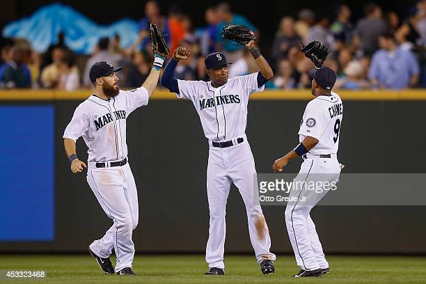 Outfielders Dustin Ackley Austin Jackson and Endy Chavez of the Seattle Mariners celebrate after defeating the Chicago White Sox 133 at Safeco Field...