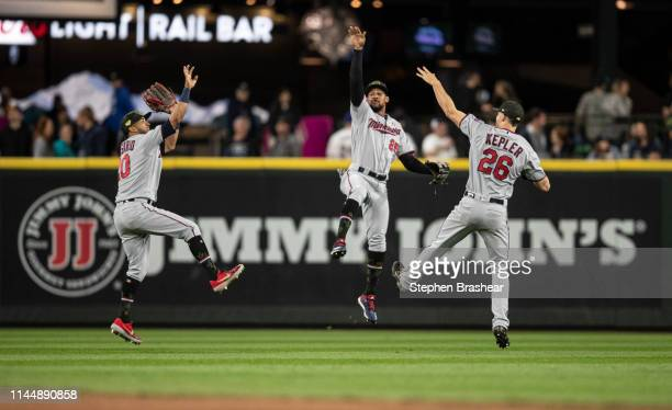 Outfielders Eddie Rosario of the Minnesota Twins Byron Buxton and Max Kepler celebrate after a game against the Seattle Mariners at TMobile Park on...