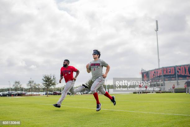 Outfielders Jackie Bradley Jr #19 and Andrew Benintendi of the Boston Red Sox sprint during a workout on February 13 2017 at jetBlue Park in Fort...