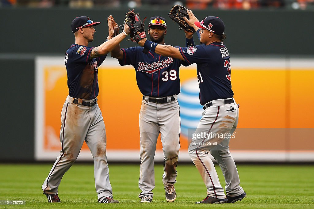Outfielders Jordan Schafer #1, Danny Santana #39 and Oswaldo Arcia #31, all of the Minnesota Twins, celebrate after defeating the Baltimore Orioles at Oriole Park at Camden Yards on September 1, 2014 in Baltimore, Maryland. The Minnesota Twins won, 6-4.