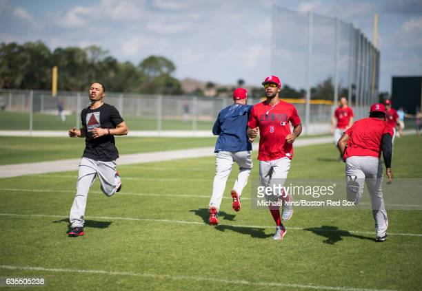 Outfielders Mookie Betts and Chris Young of the Boston Red Sox run during conditioning drills on February 15 2017 at jetBlue Park in Fort Myers...