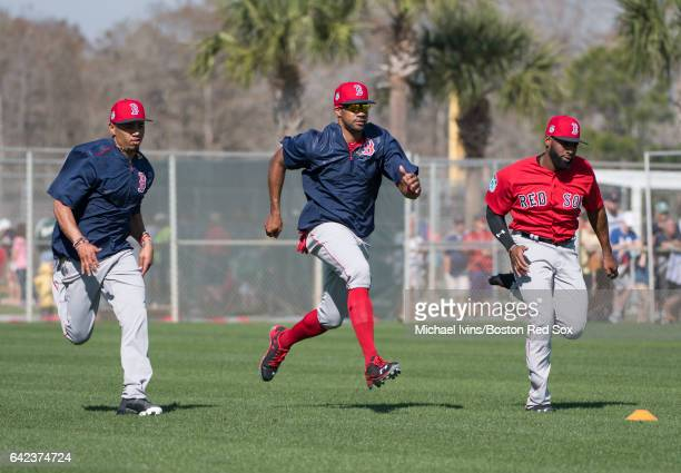 Outfielders Mookie Betts Chris Young and Jackie Bradley Jr #19 of the Boston Red Sox run sprints on February 17 2017 at jetBlue Park in Fort Myers...