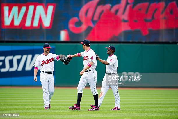 Outfielders Ryan Raburn David Murphy and Michael Bourn of the Cleveland Indians celebrate after defeating the Minnesota Twins at Progressive Field on...