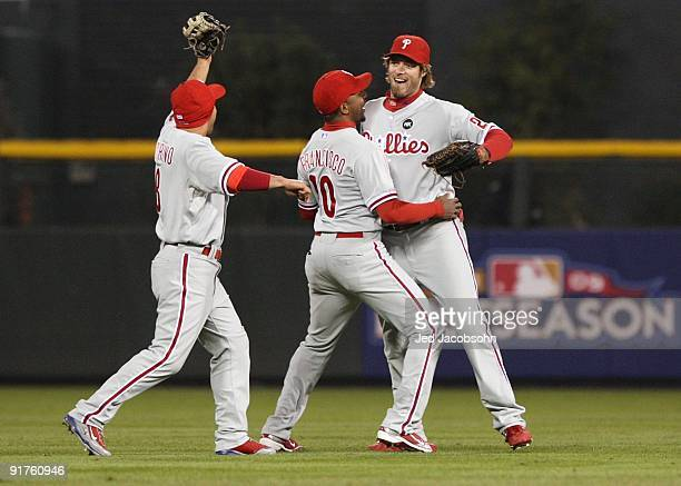 Outfielders Shane Victorino Ben Francisco and Jayson Werth of the Philadelphia Phillies celebrate after the final out for the victory in the ninth...