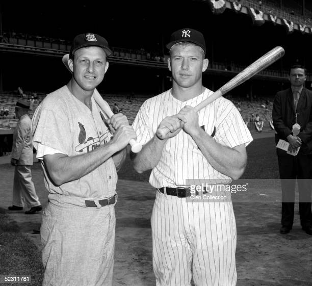 Outfielders Stan Musial of the St Louis Cardinals and Mickey Mantle of the New York Yankees pose together prior to the 1960 AllStar Game on July 13...