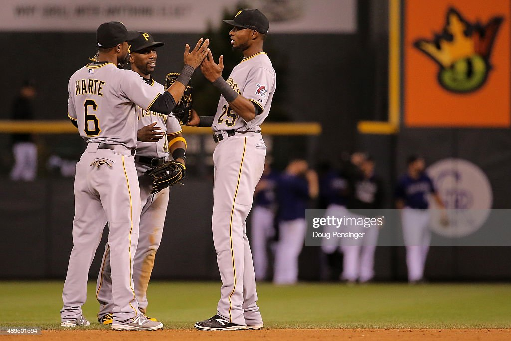 Outfielders Starling Marte #6, Andrew McCutchen #22 and Gregory Polanco #25 of the Pittsburgh Pirates celebrate their 9-3 victory over the Colorado Rockies at Coors Field on September 21, 2015 in Denver, Colorado.