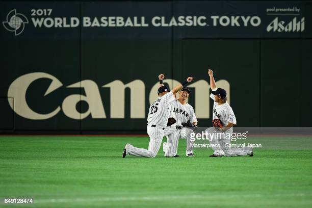 Outfielders Yoshitomo Tsutsugoh Outfielder Norichika Aoki Outfielder Ryosuke Hirata of Japan celebrate their win in the World Baseball Classic Pool B...