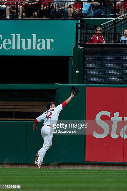 Outfileder Lance Berkman#12 of the St Louis Cardinals just misses a deep fly ball hit by Marlon Byrd of the Chicago Cubs on September 25 2011 at...