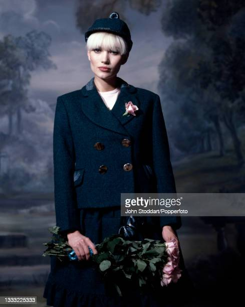Outfit from the autumn/winter Harris Tweed Collection by Vivienne Westwood, a young woman wears a two piece skirt suit in blue Harris Tweed,...