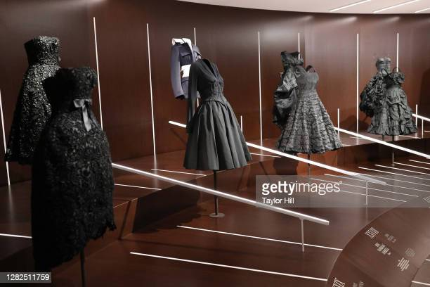 "Outfits on display at the press preview for the Costume Institute's annual exhibition ""About Time: Fashion and Duration sponsored by Louis Vuitton at..."