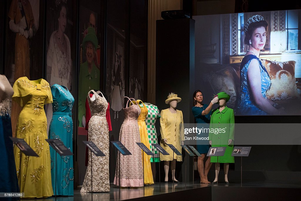 Outfits worn by Queen Elizabeth II including the coat and hat worn at the Service of Thanksgiving for her 90th birthday celebration at St Paul's Cathedral in 2016 (green) are displayed during a photocall at Buckingham Palace on July 21, 2016 in London, England. The piece makes up part of a forthcoming exhibit 'Fashioning a Reign: 90 Years of Style from The Queen's Wardrobe' to coincide with the Summer Opening of Buckingham Palace. The exhibit includes outfits worn by the Queen from State events to family celebrations and runs until October 2, 2016.