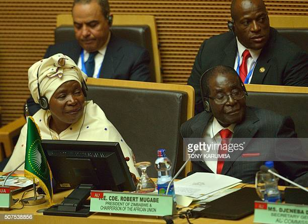 Outgoing African Union Chairman and Zimbabwe's President Robert Mugabe with Chairperson of the AU Commission Nkosazana DlaminiZuma attend the 26th...