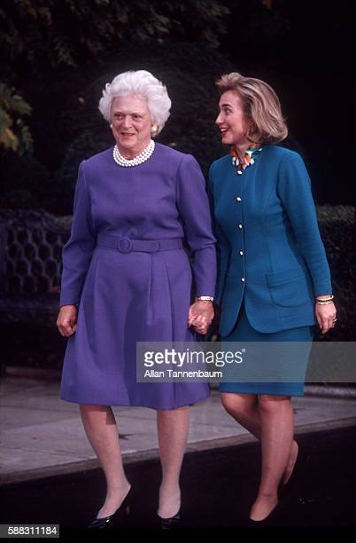 Outgoing American First Lady Barbara Bush walks with incoming First Lady American lawyer Hillary Clinton during the latter's first visit to the White...