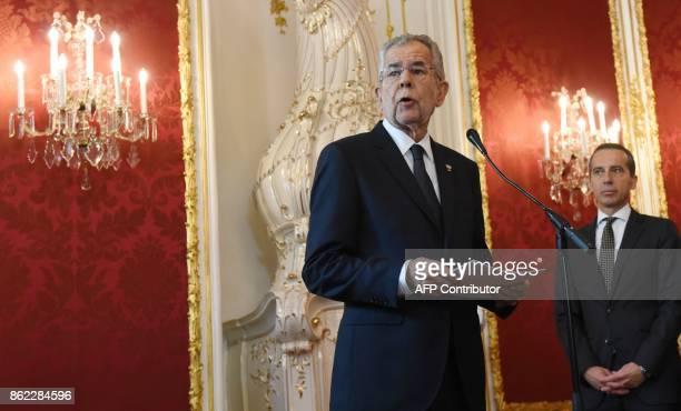 Outgoing Austrian Chancellor Christian Kern listens to Austrian President Alexander Van der Bellen during a ceremony of Austria's outgoing government...
