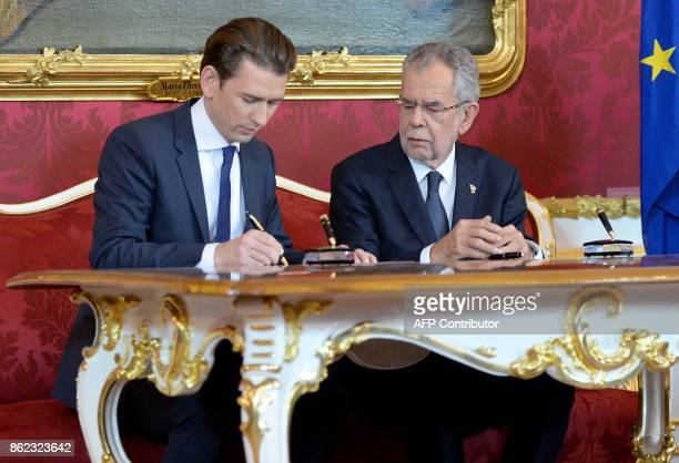 Outgoing Austrian Foreign minister Sebastian Kurz and Austrian President Alexander Van der Bellen sign documents as the outgoing government formally...