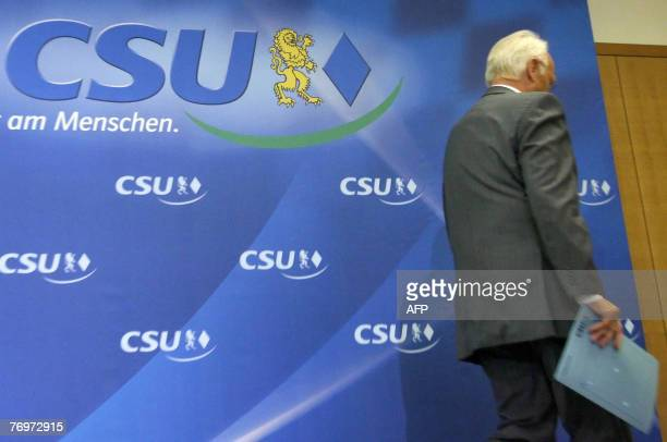 Outgoing Bavarian Premier and Christian Social Union leader Edmund Stoiber leaves the podium after addressing a press conference in the Southern...