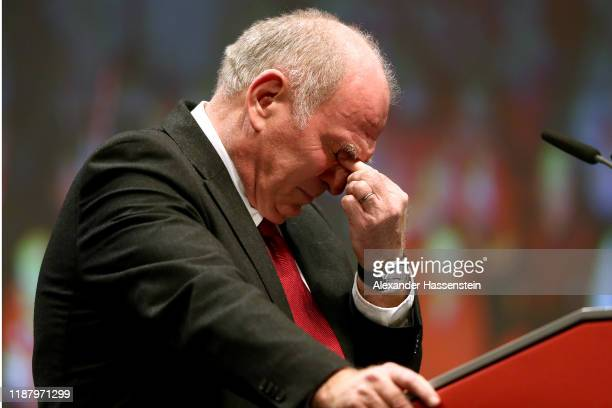 Outgoing Bayern Muenchen president Uli Hoeness reacts during his speech at the annual general meeting of FC Bayern Muenchen at Olympiahalle on...