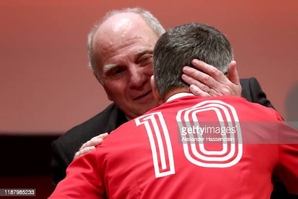Outgoing Bayern Muenchen president Uli Hoeness reacts with newly elected President Herbert Hainer at the annual general meeting of FC Bayern Muenchen...