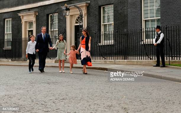 Outgoing British prime minister David Cameron leaves after speaking outside 10 Downing Street with his family son Arthur Elwen his daughter Nancy...