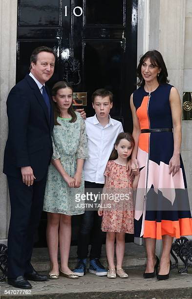 Outgoing British prime minister David Cameron poses for a photograph outside 10 Downing Street with his family his daughter Nancy Gwen son Arthur...