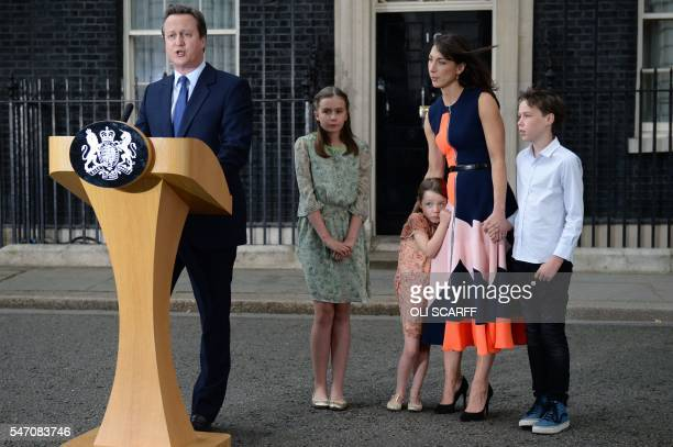 TOPSHOT Outgoing British prime minister David Cameron speaks beside his daughter Nancy Gwen daughter Florence Rose Endellion his wife Samantha...