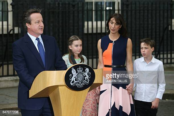 Outgoing British prime minister David Cameron speaks outside 10 Downing Street beside his daughter Nancy Gwen his wife Samantha Cameron and son...