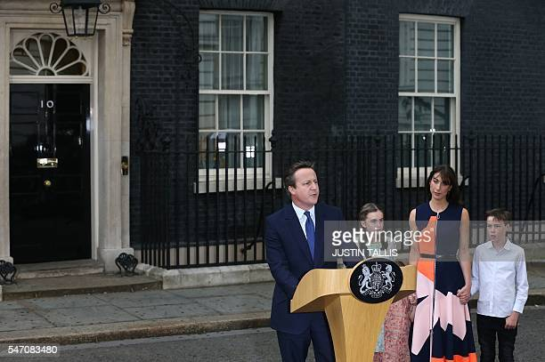 Outgoing British prime minister David Cameron speaks outside 10 Downing Street beside his daughter Nancy Gwen daughter Florence Rose Endellion his...