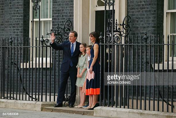 Outgoing British prime minister David Cameron waves outside 10 Downing Street with his family his daughter Nancy Gwen son Arthur Elwen daughter...