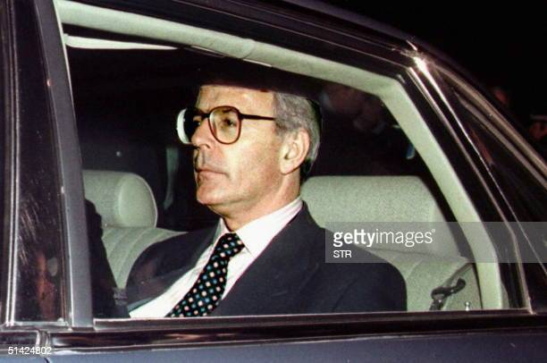 Outgoing British Prime Minister John Major leaves in his car 02 May the counting center in Saint Ives in his constituency after the announcement of...