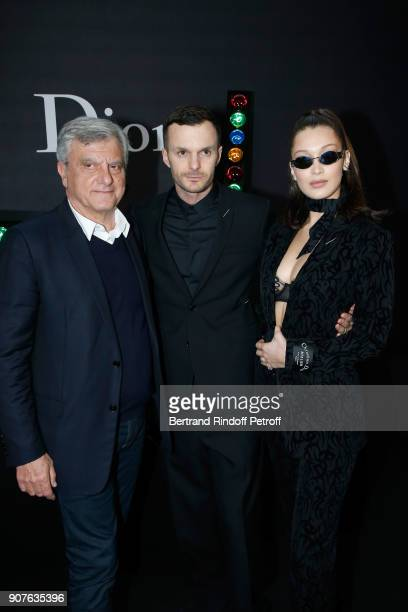 Outgoing CEO of Dior Sidney Toledano Stylist of Dior Men Kris Van Assche and model Bella Hadid pose after the Dior Homme Menswear Fall/Winter...