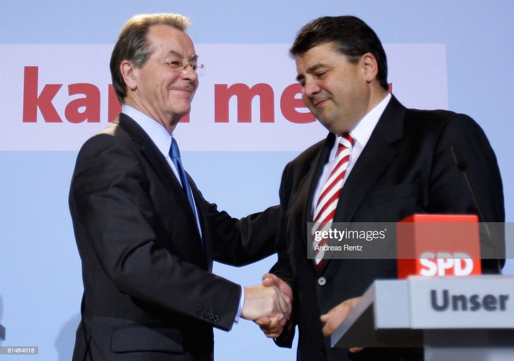 Outgoing Chairman Franz Muentefering of the German Social Democrats (SPD) and Sigmar Gabriel (R) shake hands during a press conference following a meeting of the party's executive committee at Willy-Brandt-Haus on October 5, 2009 in Berlin, Germany. Muentefering announced that the party will nominate current Minister of the Environment Sigmar Gabriel as new party chairman at the SPD national congress in November. The SPD is still reeling from disastrous results in recent German federal elections that will relegate the party out of government positions and into the opposition.