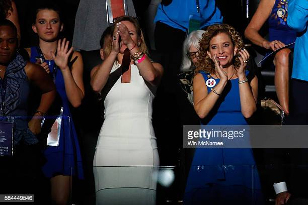 Outgoing chairperson of the Democratic National Committee Debbie Wasserman Schultz listens to Democratic presidential candidate Hillary Clinton speak...