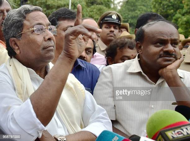 Outgoing Chief Minister of Karnataka Siddaramaiah gestures while Janatha Dal State President HD Kumaraswamy looks on as they address media after...