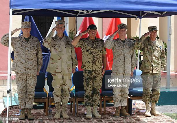 Outgoing commander of NATO troops in Afghanistan US General David Petraeus US commander of the Middle East and Afghanistan General James Mattis the...