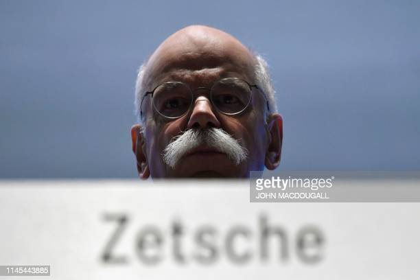 Outgoing Daimler CEO Daimler Dieter Zetsche looks on before the start of the German car maker's annual general meeting on May 22 2019 in Berlin...