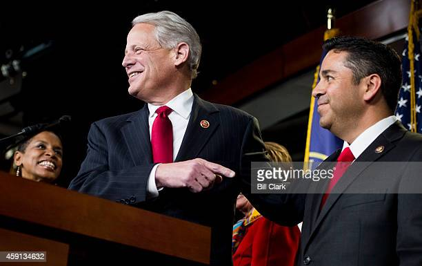 Outgoing DCCC chair Rep Steve Israel DNY left speaks about Rep Ben Ray Lujan DNM right during a press conference after Lujan was selected by Minority...