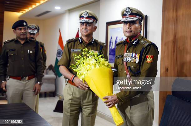 Outgoing Delhi Police Commissioner Amulya Patnaik greets Delhi Police Special Commissioner SN Srivastava , as the latter takes charge as the new...