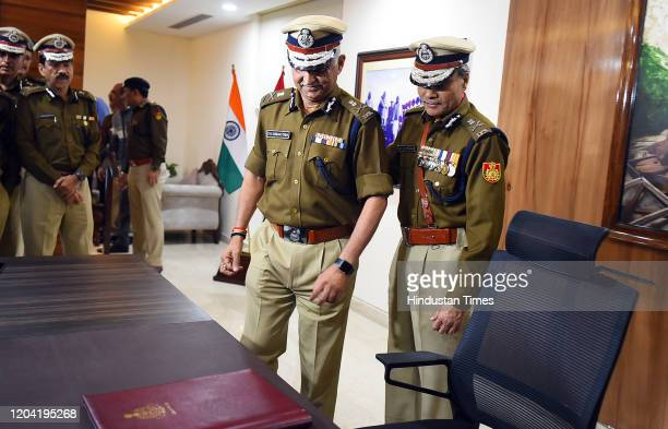 Outgoing Delhi Police Commissioner Amulya Patnaik with Delhi Police Special Commissioner SN Srivastava , as the latter takes charge as the new Police...