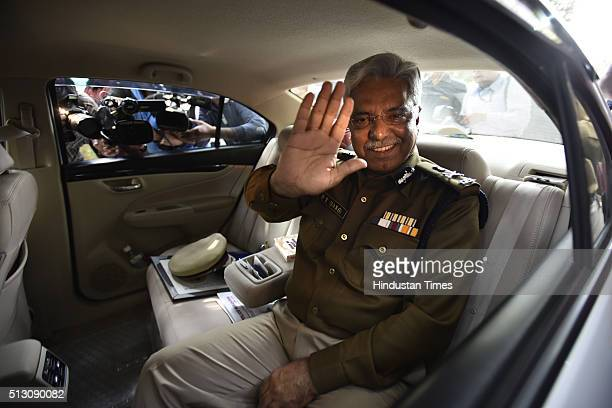 Outgoing Delhi Police Commissioner BS Bassi waves in farewell bye as he leaves PHQ after his retirement on February 29 2016 in New Delhi India Senior...