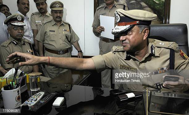 Outgoing Delhi Police Commissioner Neeraj Kumar welcomes new Commissioner of Delhi Police Bhim Sain Bassi at Delhi Police Headquarter on July 31 2013...