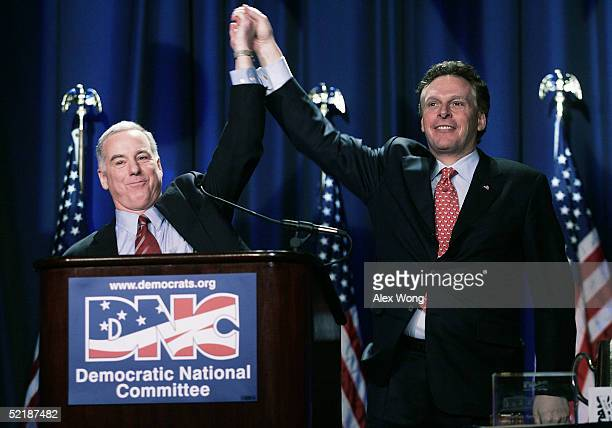 Outgoing Democratic National Committee Chairman Terry McAuliffe holds hands up with incoming Chairman Howard Dean after Dean gave his accepted speech...