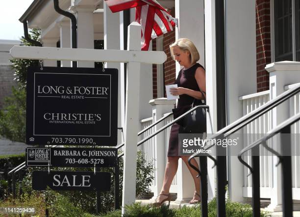 Outgoing Department of Homeland Security Secretary Kirstjen Nielsen walks out of her home to speak to the media on April 08 2019 in Alexandria...
