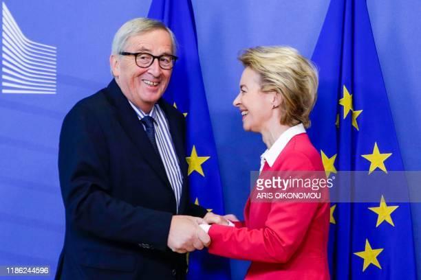 Outgoing European Commission President Jean-Claude Juncker greets the new European Commission President Ursula von der Leyen during the handing-over...