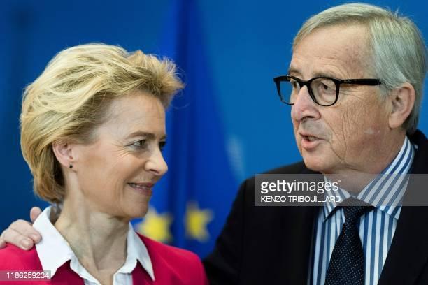Outgoing European Commission President Jean-Claude Juncker congratulates new European Commission President Ursula von der Leyen during the...